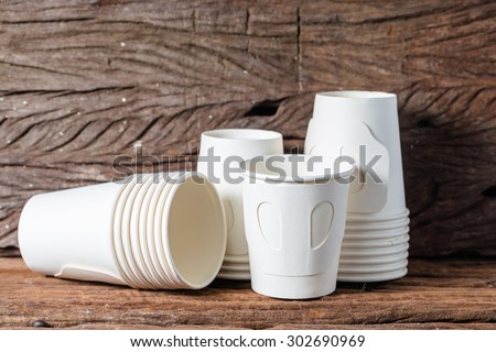 Paper cup of coffee on wooden texture background - stock photo