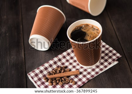 paper cup of hot coffee on wooden table - stock photo