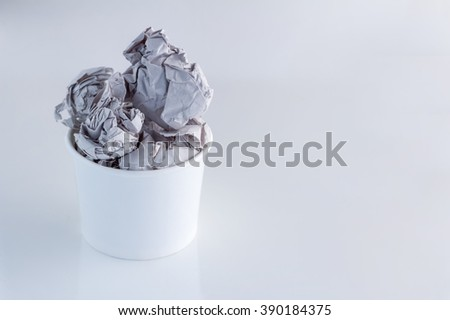 paper cup of paper trash ball on white background.jpg - stock photo
