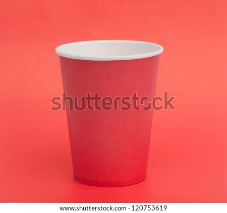 Paper cup on a red background