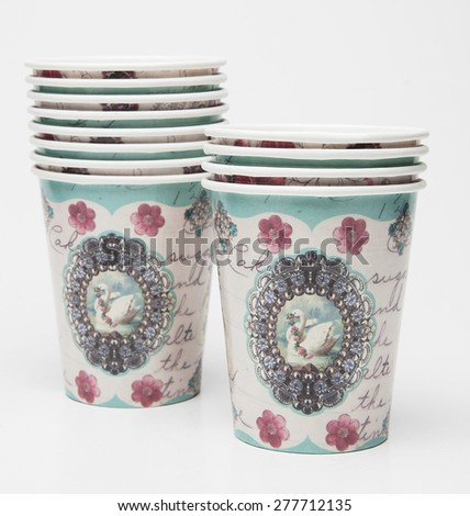 Paper cups with ornaments - stock photo