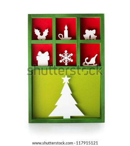 Paper cut Christmas decoration (hand cut) in a wooden display tray. - stock photo