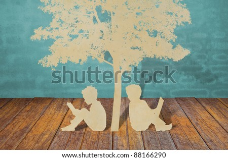 Paper cut of children read a book under tree - stock photo