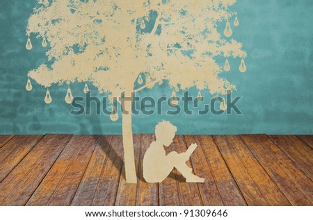 Paper cut of children read a book under tree of bulb - stock photo