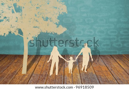 Paper cut of family symbol - stock photo