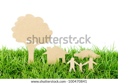Paper cut of family with house , tree and car on fresh spring green grass - stock photo