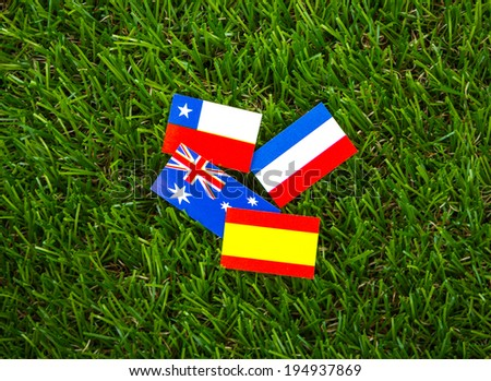 Paper cut of flags on grass for Soccer championship 2014 , group B