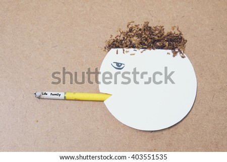 paper cut of head destroyed by  cigarette -Life and Family concept - stock photo