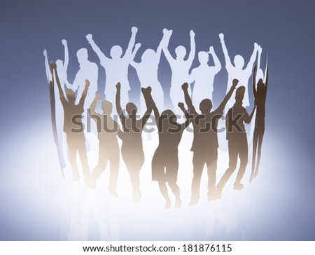 Paper Cut Out Of People Raising Hand - stock photo