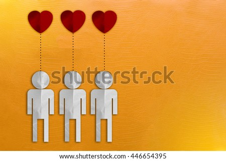 paper cut people together in love on yellow leather background - stock photo