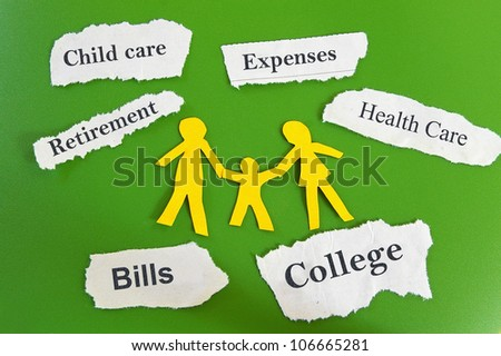 Paper cutout family with expenses on torn paper scraps - stock photo