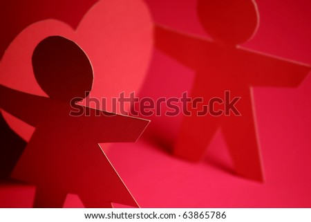 paper cutout of a man and woman - stock photo