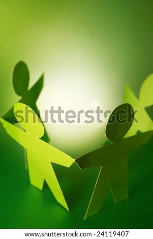 paper cutouts holding hands - stock photo