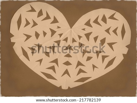 Paper decorated heart on grunge brown background - stock photo