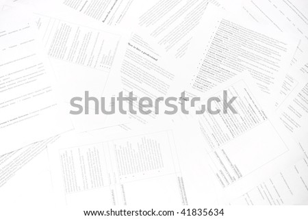 Paper documents scattered with text, information and data. Symbol of bureaucracy - stock photo