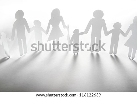 Paper doll family holding hands - stock photo