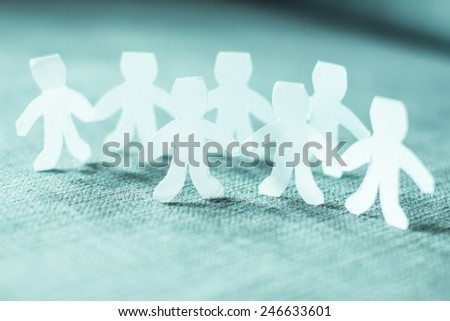 Paper doll people chain teamwork. - stock photo