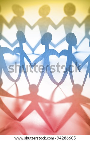 Paper doll people holding hands - stock photo