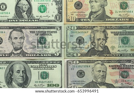 Paper dollars of different denominations - 1, 5, 10, 20, 50 and 100 dollars. Background of dollars.