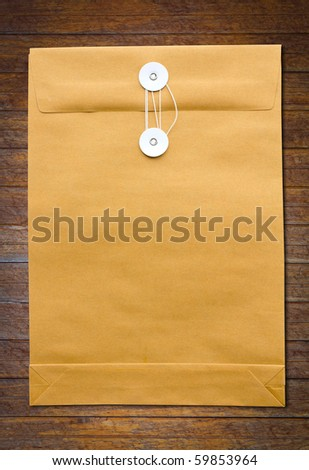 Paper Envelope on wood wall - stock photo