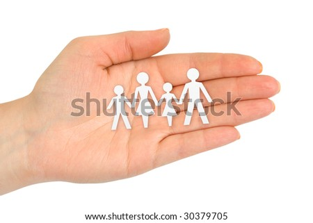 Paper family in hand isolated on white background