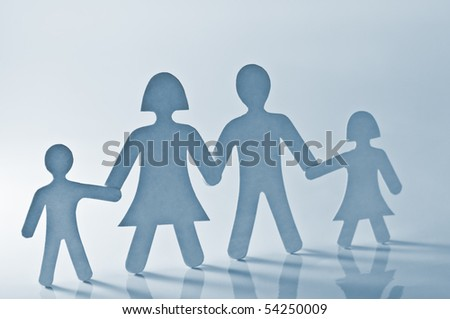 paper family on blue background - stock photo