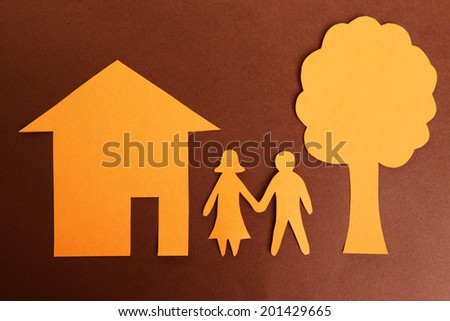 Paper family on brown background - stock photo