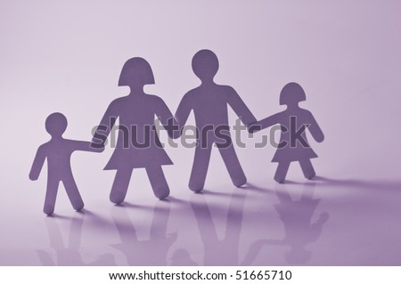 paper family on pink background - stock photo