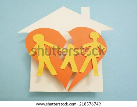 Paper family over torn heart, on house - divorce concept                                - stock photo