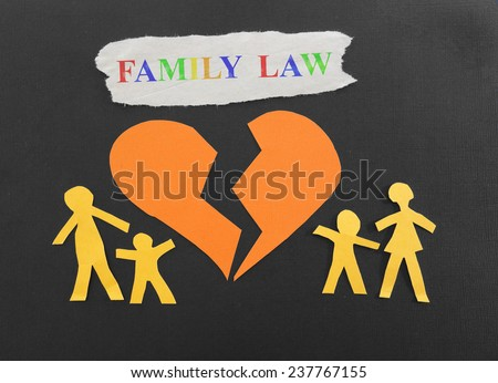 Paper family with broken heart and Family Law text                                - stock photo