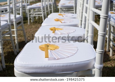 Paper fan on the wedding chair - stock photo