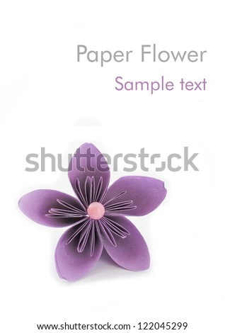 Paper flower with sample text - stock photo