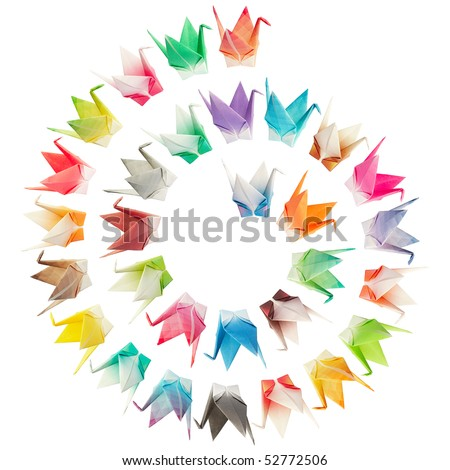 Paper folded birds arranged in a spiral shape and isolated on a white background - stock photo