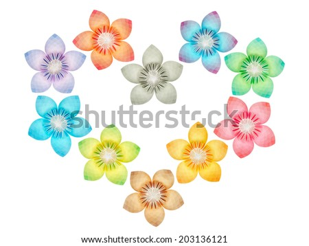 Paper folded flowers arranged in a heart shape, isolated on a white background  - stock photo