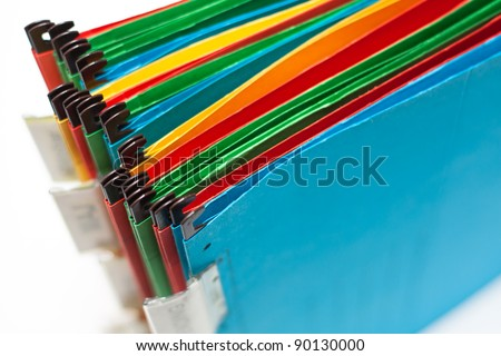 Paper folders in different colors with labels