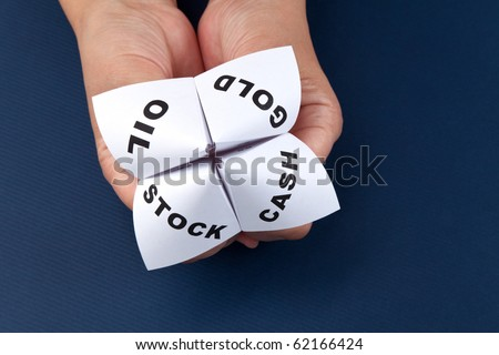 Paper Fortune Teller, Gold; Oil; Cash; Stock, concept of business decision - stock photo
