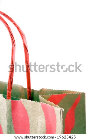 Paper gift bag with handles isolated on white