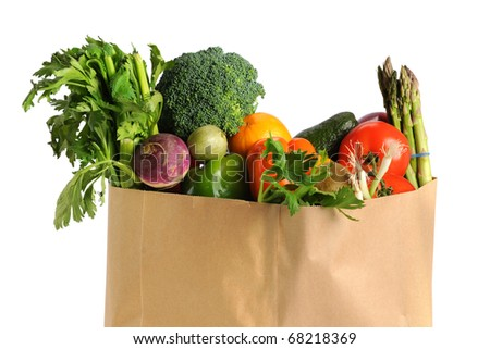 Paper grocery bag with fruits and vegetables isolated over white background - stock photo