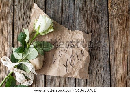 Paper grunge background with rose. - stock photo