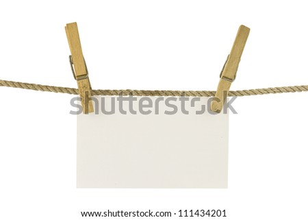 paper hang on clothesline with clipping path - stock photo