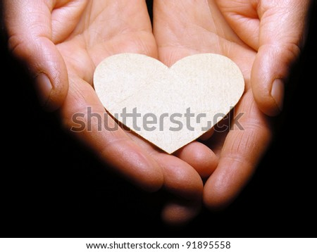 Paper heart in hands - stock photo