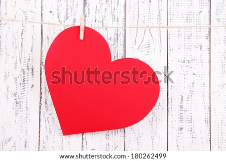 Paper heart on wooden background - stock photo