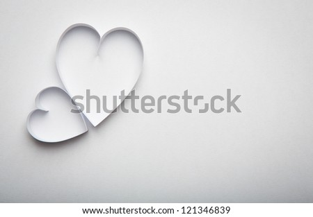 Paper  heart shape symbol for Valentines day  with copy space for text or design - stock photo