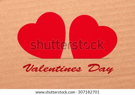Paper hearts on brown background, close up - stock photo