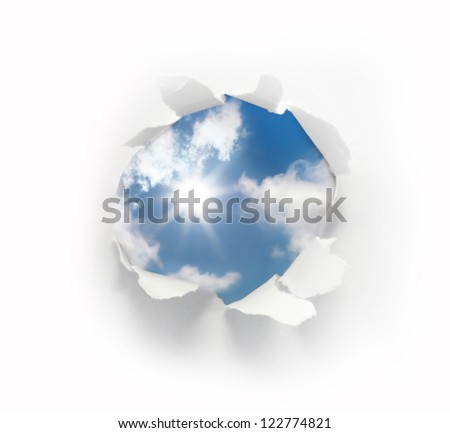 paper hole with blue sky and sun - stock photo