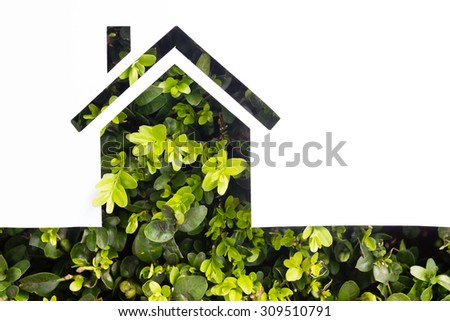 Paper house against green background. Real Estate Concept