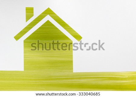 Paper house against green background. Real Estate Concept. Top view. - stock photo