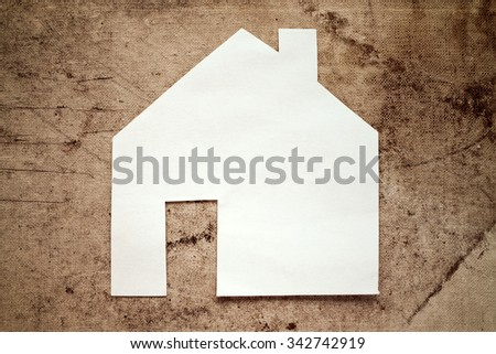 Paper house icon on dirty canvas background - stock photo