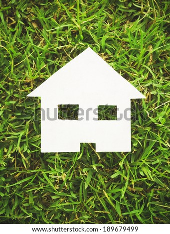Paper house on green grass (vintage style)