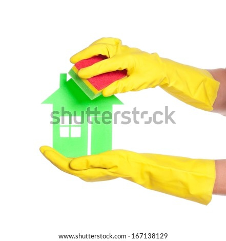 Paper house on woman hands in gloves isolated on white background - stock photo
